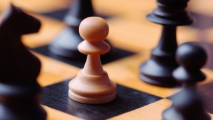 Chess pieces on chessboard --- Image by © Royalty-Free/Corbis