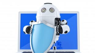 Robot with shielad and laptop.